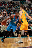 Oklahoma City Thunder v New Orleans Hornets: Kevin Durant and Jason Smith Photographic Print by  Chris