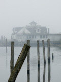 View Through Fog of an Old Fishing Cabin and Wood Pilings Photographic Print by Todd Gipstein