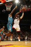 New Orleans Hornets v Miami Heat: Dwyane Wade and Emeka Okafor Photographic Print by Issac