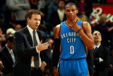 Oklahoma City Thunder v New Orleans Hornets: Scott Brooks and Russell Westbrook Photographic Print by  Chris