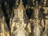 Buddha Statues Wrapped in Plastic Photographic Print by Alison Wright