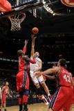 New Jersey Nets v Toronto Raptors: Linas Kleiza and Johan Petro Photographic Print by Ron Turenne