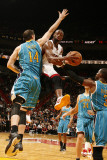 New Orleans Hornets v Miami Heat: Dwyane Wade and Jason Smith Photographic Print by Issac