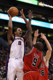 Chicago Bulls v Phoenix Suns: Channing Frye and Luol Deng Photographic Print by Christian Petersen