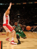 Boston Celtics v Toronto Raptors: Nate Robinson and Andrea Bargnani Photographic Print by Ron Turenne