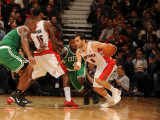 Boston Celtics v Toronto Raptors: Jose Calderon, Amir Johnson and Nate Robinson Photographic Print by Ron Turenne