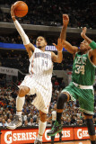 Boston Celtics v Charlotte Bobcats: Paul Pierce and D.J. Augustin Photographic Print by Kent Smith