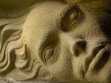 A Stone Carving of a Face Photographic Print by Jim Richardson