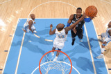 Orlando Magic v Denver Nuggets: Dwight Howard and Melvin Ely Photographic Print by Garrett Ellwood