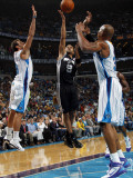 San Antonio Spurs v New Orleans Hornets: Tony Parker and David West Photographic Print by Layne Murdoch