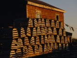 Neatly Stacked Lobster Traps at a Fishing Camp, Gros Morne Np, Newfoundland, Canada Photographic Print by Raymond Gehman