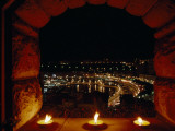 A Night View of Monaco over a Ledge with Candles Photographic Print by Jodi Cobb