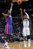 Detroit Pistons v New Orleans Hornets: Chris Paul and Rodney Stuckey Photographic Print by Layne Murdoch