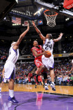 Houston Rockets v Sacramento Kings: Aaron Brooks and Carl Landry Photographic Print by Rocky Widner