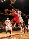 Houston Rockets v Toronto Raptors: Kevin Martin and Amir Johnson Photographic Print by Ron Turenne