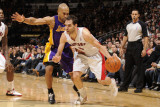 Los Angeles Lakers v Toronto Raptors: Jose Calderon and Derek Fisher Photographic Print by Ron Turenne
