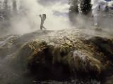 Venting Steam Veils a Hiker Skirting a Hot Spring in the Bechler Backcountry Photographic Print by Raymond Gehman