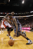 Charlotte Bobcats v Miami Heat: Tyrus Thomas and Udonis Haslem Photographic Print by Mike Ehrmann