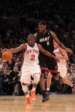 Miami Heat v New York Knicks: Raymond Felton and LeBron James Photographic Print by Al Bello