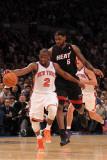 Miami Heat v New York Knicks: Raymond Felton and LeBron James Photographic Print by Al Bello