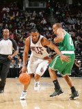 Boston Celtics v New Jersey Nets: Stephen Graham and Avery Bradley Photographic Print by Jeyhoun Allebaugh