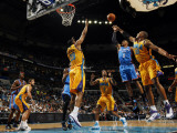 Oklahoma City Thunder v New Orleans Hornets: Russell Westbrook and David West Photographic Print by Layne Murdoch
