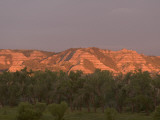 Eroded Hills Shot at Sunrise in Little Missouri National Grasslands Photographic Print by Phil Schermeister