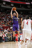 Sacramento Kings v Houston Rockets: Beno Udrih and Luis Scola Photographic Print by Bill Baptist