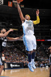 San Antonio Spurs v Denver Nuggets: Carmelo Anthony and Tim Duncan Photographic Print by Garrett Ellwood