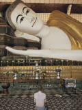 A Man Prays before the Reclining Shwethalyaung Buddha Statue Photographic Print by Alison Wright