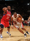 Philadelphia 76ers v Toronto Raptors: Leandro Barbosa and Jodie Meeks Photographic Print by Ron Turenne