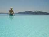 A Woman at an Infinity Pool Overlooking the Aegean Sea Photographic Print by Richard Nowitz