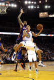 New York Knicks v Golden State Warriors: Stephen Curry and Wilson Chandler Photographic Print by Ezra Shaw
