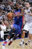 Detroit Pistons v Dallas Mavericks: Rodney Stuckey and Jose Juan Barea Photographic Print by Glenn James
