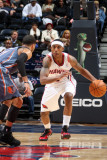 Charlotte Bobcats v Atlanta Hawks: Jeff Teague and D.J. Augustin Photographic Print by Scott Cunningham