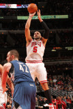 Minnesota Timberwolves v Chicago Bulls: Carlos Boozer and Kevin Love Photographic Print by Ray Amati