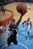 San Antonio Spurs v New Orleans Hornets: Tim Duncan Photographic Print by Layne Murdoch