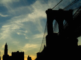 Skyward View of the Brooklyn Bridge Silhouetted Against a Blue Sky Photographic Print by Todd Gipstein