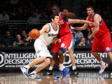 Philadelphia 76ers v Washington Wizards: Kirk Hinrich and Jrue Holiday Photographic Print by Ned Dishman