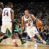 Boston Celtics v New Jersey Nets: Jordan Farmar, Derrick Favors and Nate Robinson Photographic Print by Nathaniel S. Butler