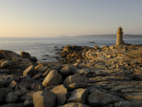 A Beacon Light on a Rocky Coast Photographic Print by Jim Richardson