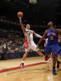 New York Knicks v Toronto Raptors: Jerryd Bayless and Shawne Williams Photographic Print by Ron Turenne