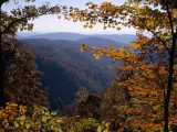 A Blue Ridge Mountain Escarpment Framed by Maple Trees in Autumn Hues Photographie par Raymond Gehman