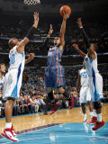 Charlotte Bobcats v New Orleans Hornets: D.J. Augustin, David West and Chris Paul Photographic Print by Layne Murdoch