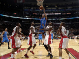 Oklahoma City Thunder v Toronto Raptors: Ed Davis, Amir Johnson and Russell Westbrook Photographic Print by Ron Turenne