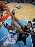 San Antonio Spurs v New Orleans Hornets: David West and Tim Duncan Photographic Print by Layne Murdoch