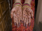 A Henna Tattoo Is Painted on Hands in Celebration of Diwali Photographic Print by Jodi Cobb