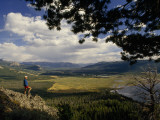 A Hiker Looks over the Teton Wilderness Area, Wyoming Photographic Print by Raymond Gehman