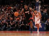 Miami Heat v New York Knicks: LeBron James and Landry Fields Photographic Print by Al Bello