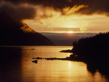 Cloud-Filtered Sunset Silhouettes a Boat on the Sheltered Waters of Bonne Bay Photographic Print by Raymond Gehman